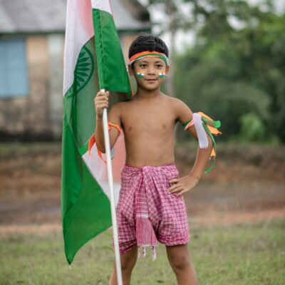 boy-holding-a-flag-of-india-2802368-scaled